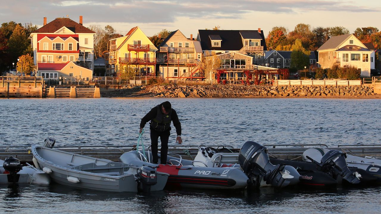 A man in St. Andrews prepares to take a boat into Passamaquoddy Bay.