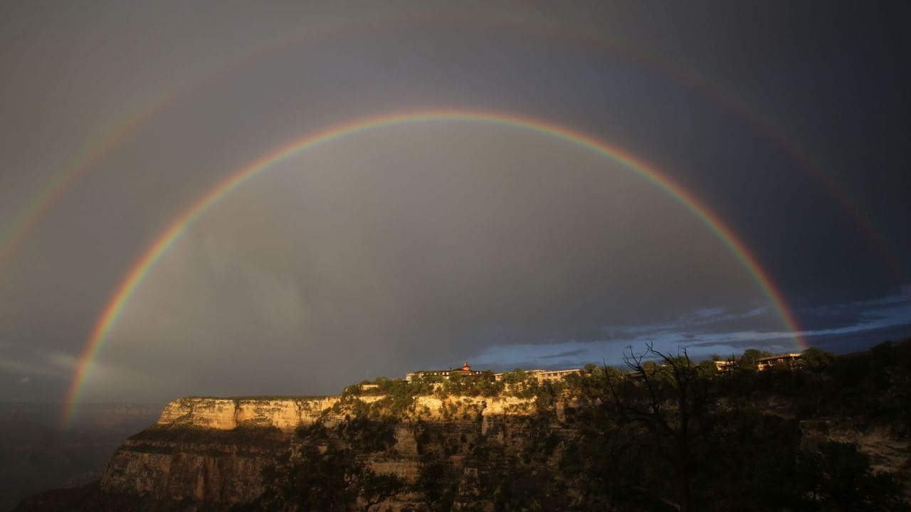 A double rainbow shines over El Tovar Hotel on the Grand Canyon's South Rim the night before the hike.