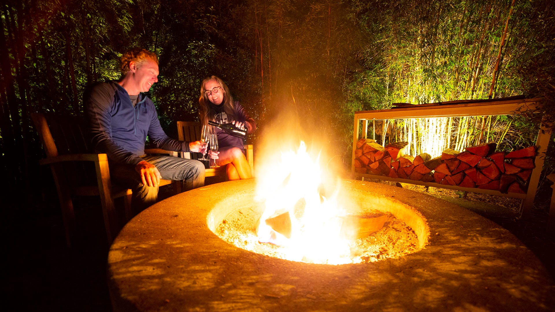 Brad and Tonya Clement enjoy champagne by firelight at their glamping accommodations.