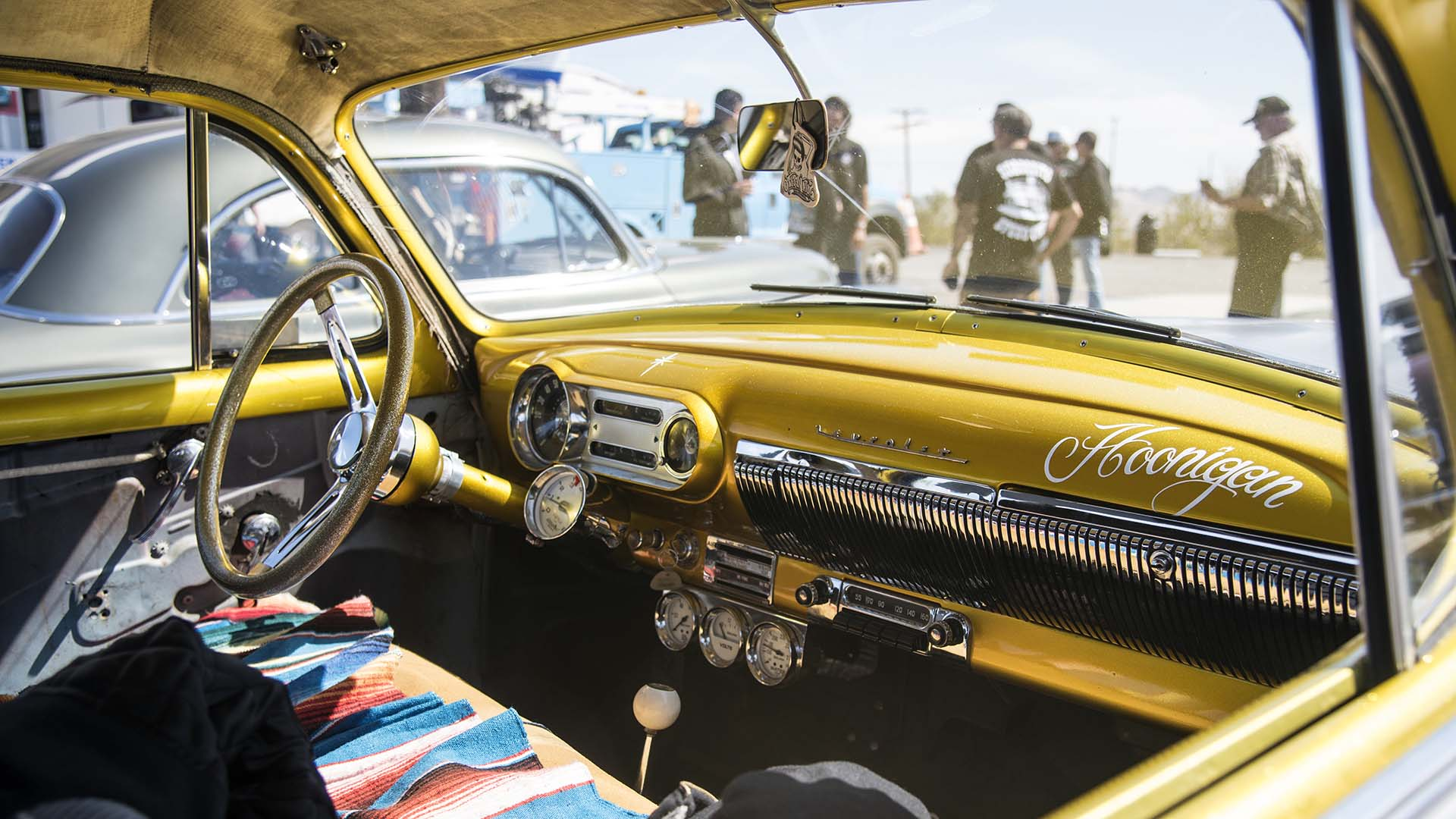 Classic hot rod enthusiasts take a break from driving old Route 66 in Ludlow, California.
