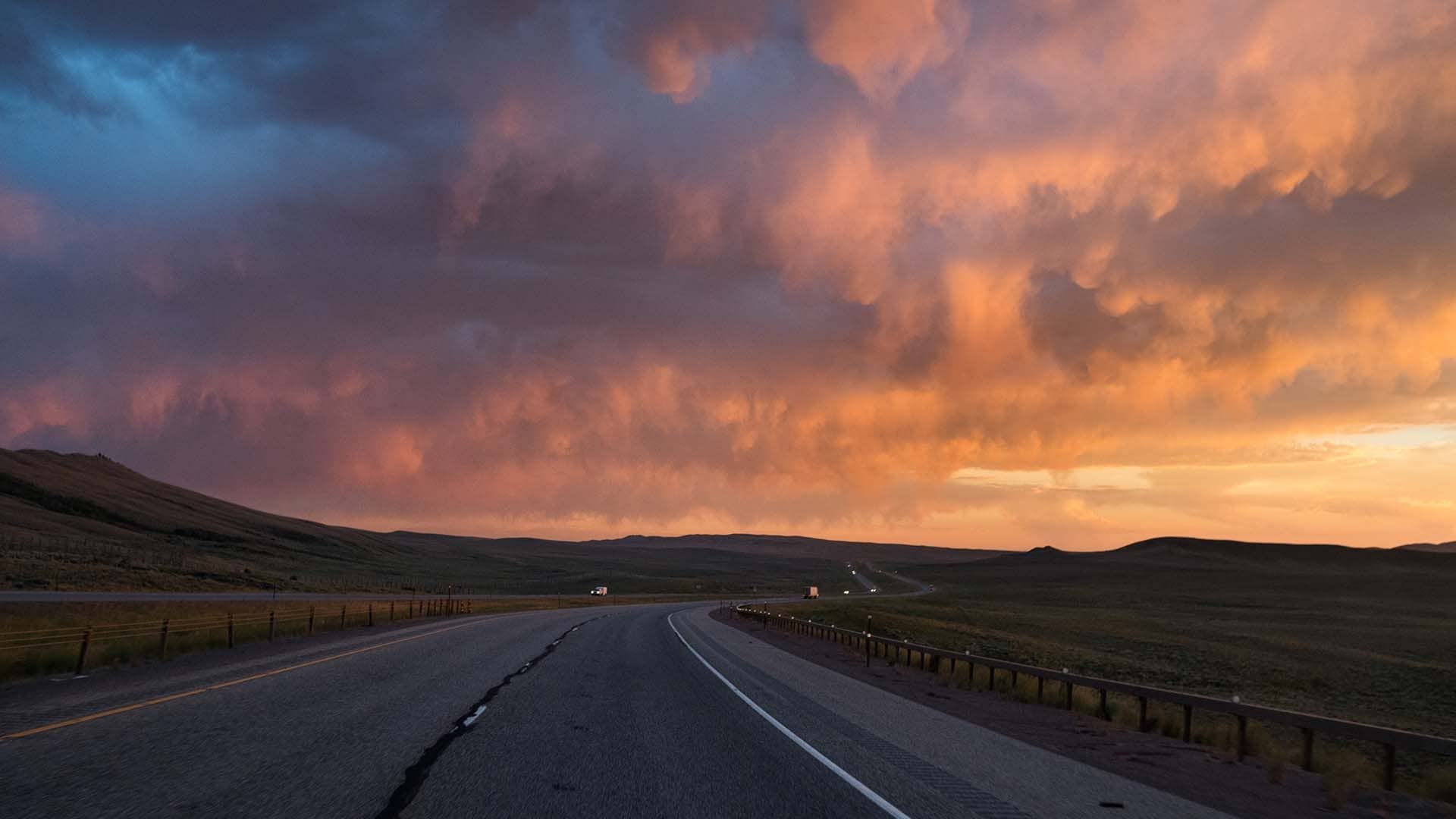 The sun sets on Interstate 80 in southern Wyoming. Afternoon thunderstorms are common during the summer.